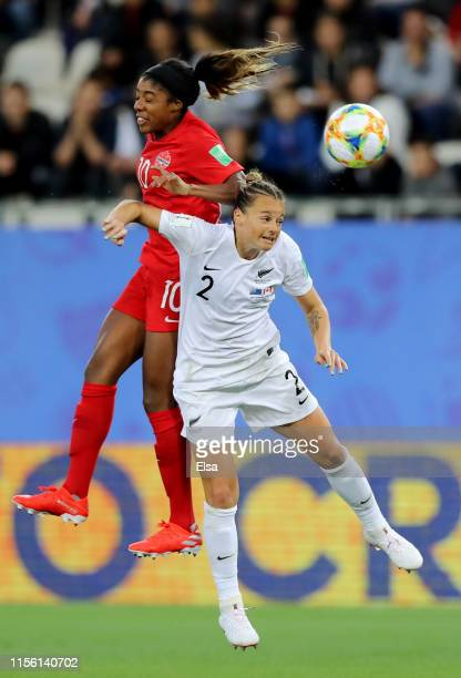Ashley Lawrence of Canada competes for a header wtih Ria Percival of New Zealand during the 2019 FIFA Women's World Cup France group E match between...