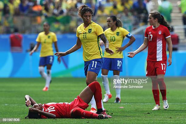 Ashley Lawrence of Canada stays down after a tackle during the Women's Olympic Football Bronze Medal match between Brazil and Canada at Arena...