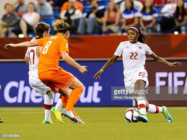 Ashley Lawrence of Canada tries to move the ball near Sherida Spitse of the Netherlands during the 2015 FIFA Women's World Cup Group A match at...