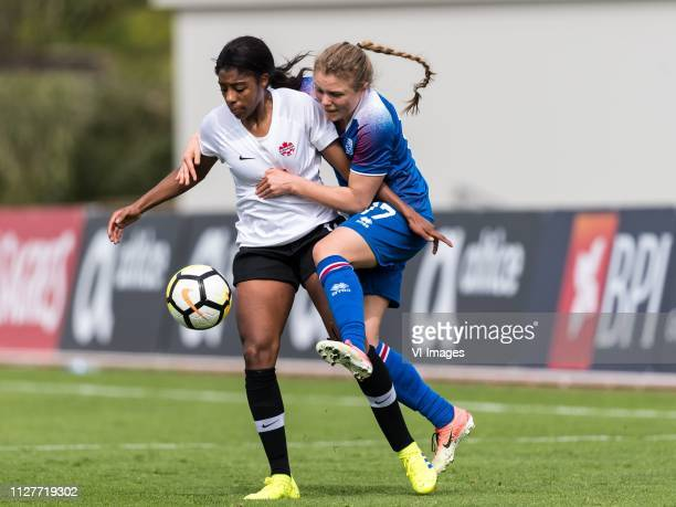 Ashley Lawrence of Canada women Agla Maria Albertsdottir of Iceland women during the Algarve Cup 2019 match between Canada and Iceland at Estadio...