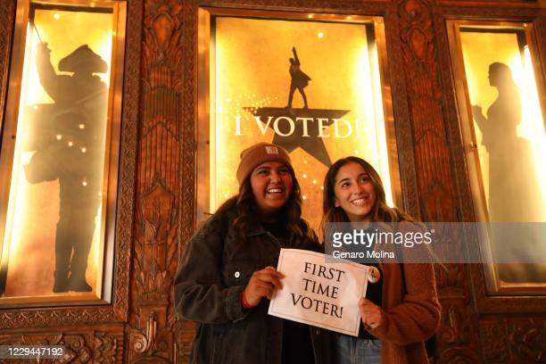 Ashley Lopez left, and her best friend Marlin Franco from Paramount, have their picture made after voting for their first time on Election Day at the...