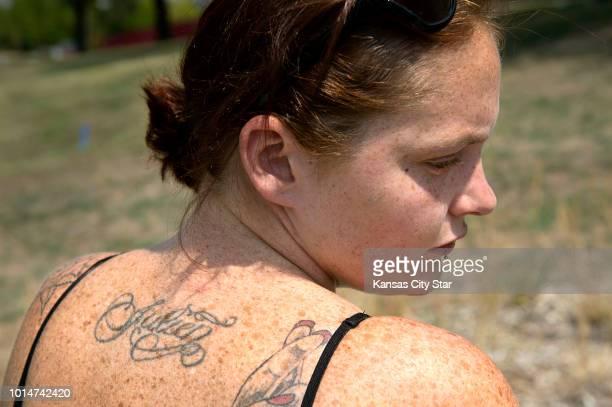 Ashley Lyons has her son's name Julien tattooed on her back She was outside Children's Mercy Hospital in Kansas City Mo on Friday Aug 10 where Julien...