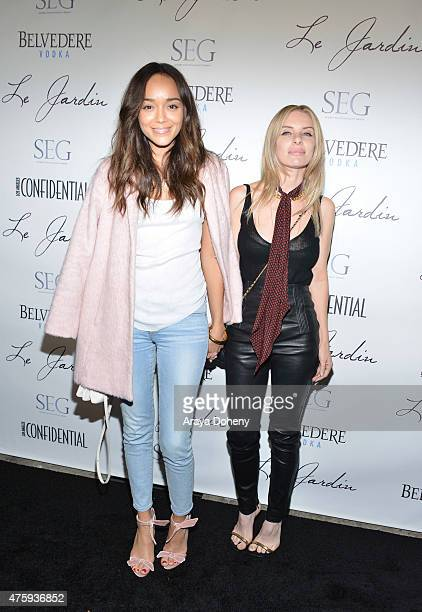 Ashley Madekwe and Joey Tierney attend the Grand Opening Of Le Jardin on June 4 2015 in Hollywood California