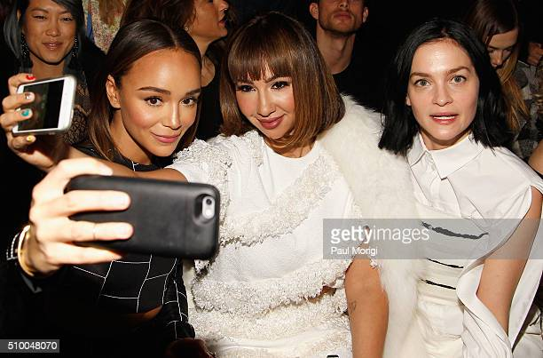Ashley Madekwe Jackie Cruz and Leigh Lezark attend the Christian Siriano Fall 2016 fashion show during New York Fashion Week at ArtBeam on February...