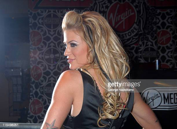 Ashley Massaro during Ashley Massaro Autographs the April Issue of Playboy at the Virgin Megastore in Times Square at Virgin Megastore Times Square...