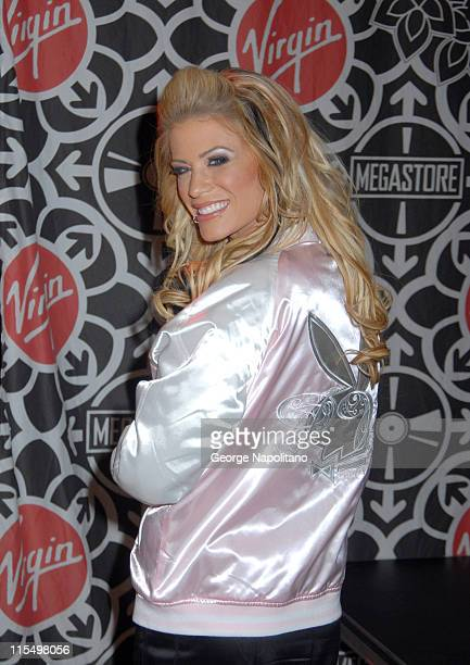 Ashley Massaro during Ashley Massaro Autographs the April Issue of Playboy at the Virgin Megastore in Times Square at Virgin Megastore Times Square...