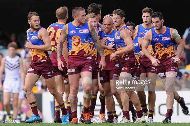 Ashley McGrath of the Lions celebrates kicking a goal with team mates during the round 22 AFL match between the Brisbane Lions and the Fremantle...