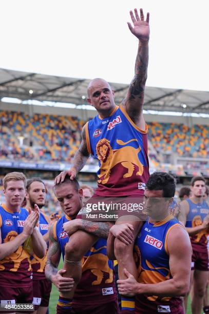 Ashley McGrath of the Lions is chaired off the field after the round 22 AFL match between the Brisbane Lions and the Fremantle Dockers at The Gabba...