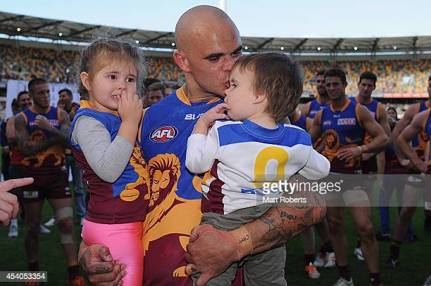Ashley McGrath of the Lions kisses his son Chase and holds duaghter Mikayla after the round 22 AFL match between the Brisbane Lions and the Fremantle...
