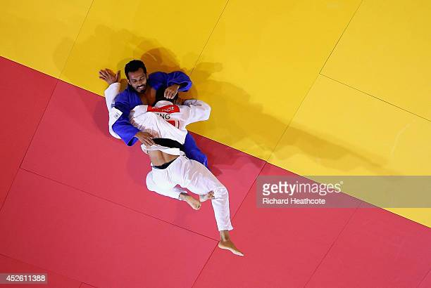Ashley McKenzie of England defeats Navjot Chana of India to win gold in the 60kg Men's final at SECC Precinct during day one of the Glasgow 2014...