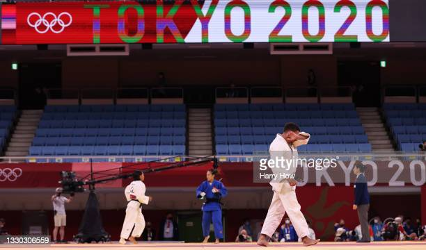 Ashley McKenzie of Great Britain reacts after losing to Karamat Huseynov of Azerbaijan during the Men's Judo 60kg Elimination Round of 32 on day one...