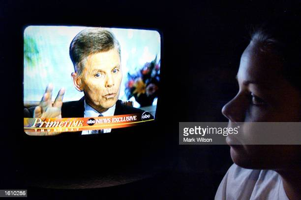 Ashley Mitchell watches Rep. Gary Condit being interviewed on television August 23, 2001 in Huntingtown, MD. Condit said he did have a close...