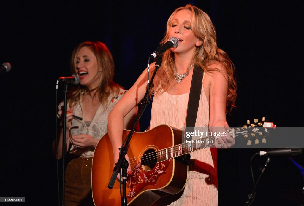 Ashley Monroe (right) is joined onstage by Singer/Songwriter Jessi Alexander during the Ashley Monroe Album Release Party for ' Like a Rose' at 3rd & Lindsley on March 7, 2013 in Nashville, Tennessee.
