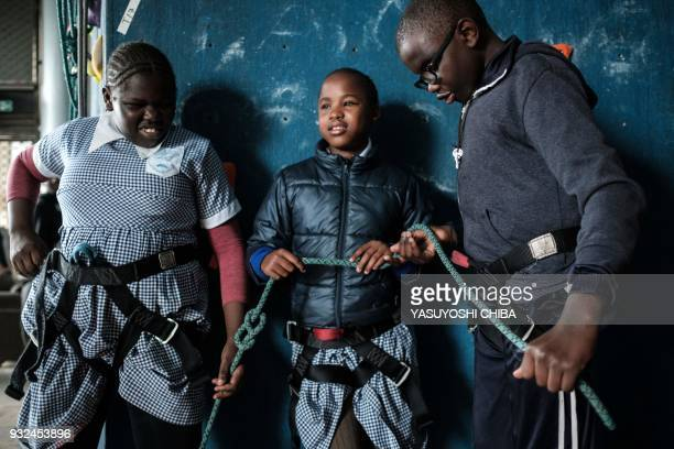 Ashley Muthoni and Ashley Wafula touch the rope during a weeklong free climbing training for visually impaired and blind students by the Japanese NPO...