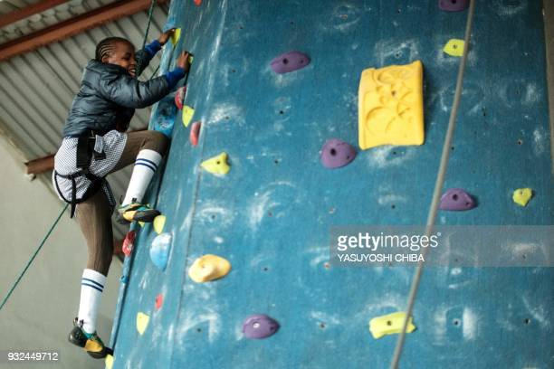 Ashley Muthoni challenges rope climbing on the artificial climbing wall during a weeklong free climbing training for visually impaired and blind...