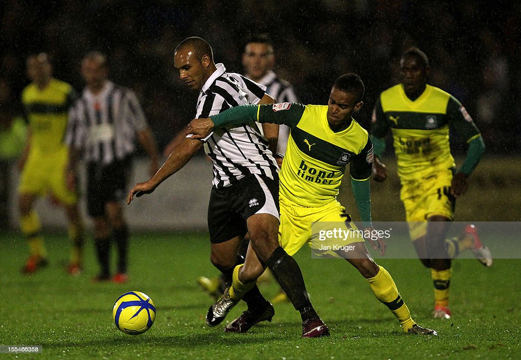Ashley Nichols of Dorchester Town battles with Paris Cowan-Hall of Plymouth Argyle during the FA Cup with Budweiser 1st Round match between Dorchester Town and Plymouth Argyle at The Avenue Stadium on November 4, 2012 in Dorchester, England.