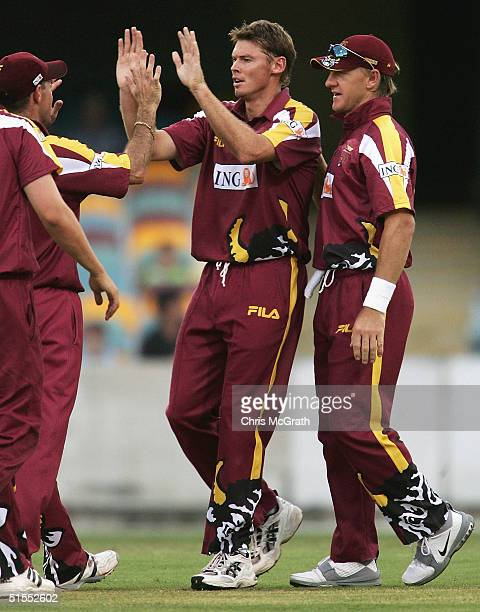 Ashley Noffke of the Bulls is congratulated by team mates after taking the wicket of Mark Cosgrove of the Redbacks during the ING Cup match between...