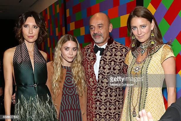 Ashley Olsen and designer Christian Louboutin attend the Louis Vuitton Monogram Celebration at Museum of Modern Art on November 7 2014 in New York...