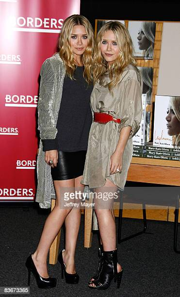 Ashley Olsen and Mary Kate Olsen pose at the Mary Kate and Ashley Olsen signing their book Influence at Borders on November 12 2008 in Westwood...