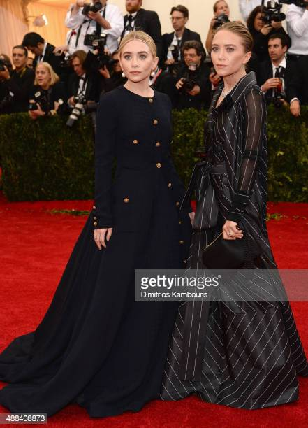 Ashley Olsen and MaryKate Olsen attend the Charles James Beyond Fashion Costume Institute Gala at the Metropolitan Museum of Art on May 5 2014 in New...