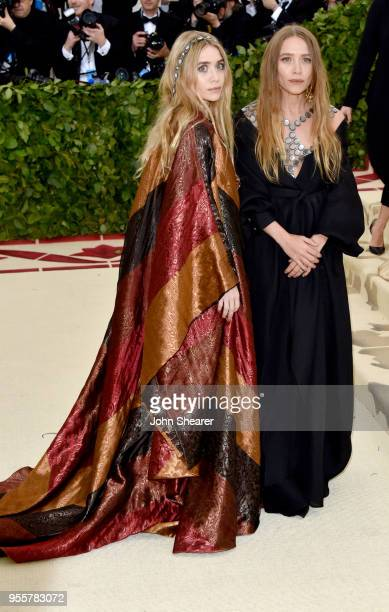 Ashley Olsen and MaryKate Olsen attend the Heavenly Bodies Fashion The Catholic Imagination Costume Institute Gala at The Metropolitan Museum of Art...