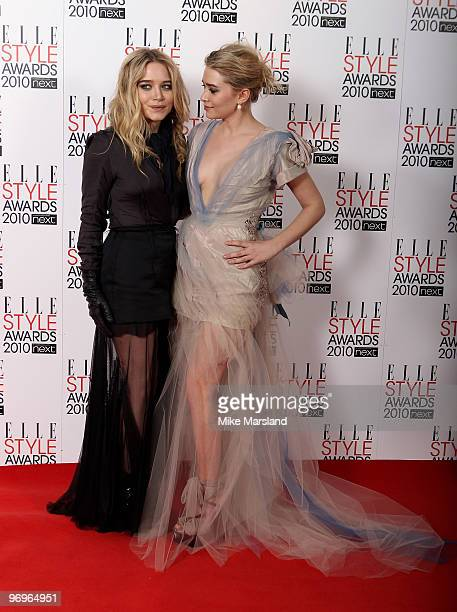 Ashley Olsen and Mary-Kate Olsen pose after winning the Style Icon Award in the Winner's room at the ELLE Style Awards 2010 at the Grand Connaught...