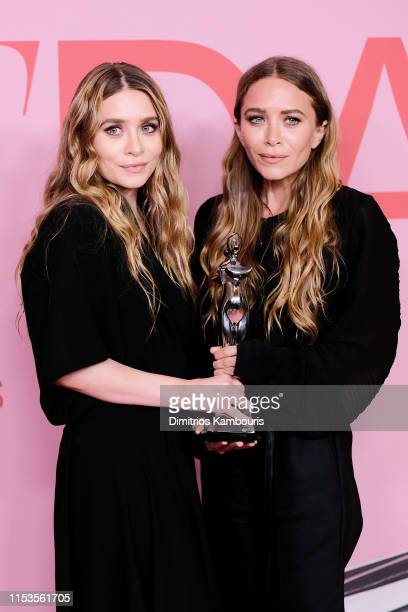 Ashley Olsen and Mary-Kate Olsen pose with Accessory Designer of the Year Award during the Winners Walk during the CFDA Fashion Awards at the...