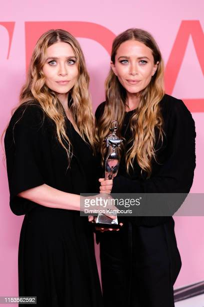 Ashley Olsen and MaryKate Olsen pose with Accessory Designer of the Year Award during the Winners Walk during the CFDA Fashion Awards at the Brooklyn...