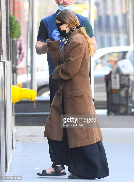 Ashley Olsen wears protective face mask and gloves in Soho on May 14 2020 in New York City