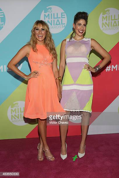 Ashley Perez and Hanna Perez of HaAsh attend the MTV Millennial Awards 2014 red carpet at Pepsi Center WTC on August 12 2014 in Mexico City Mexico
