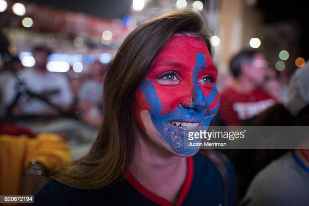 Ashley Peters of Cleveland watches the big screen outside of Progressive Field during game 7 of the World Series between the Cleveland Indians and...