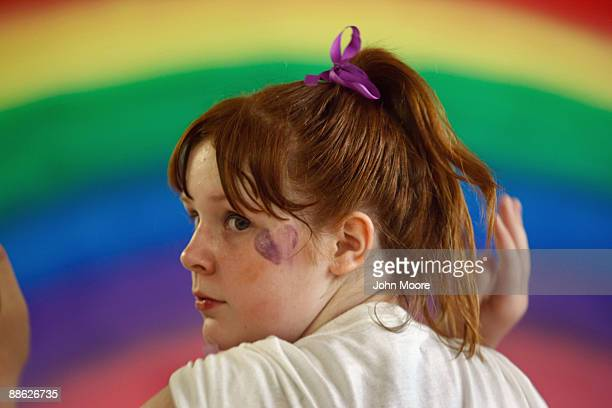 Ashley Potts prepares to practice a dance routine for a talent show at a homeless shelter on June 20, 2009 in Dallas, Texas. She was living with her...