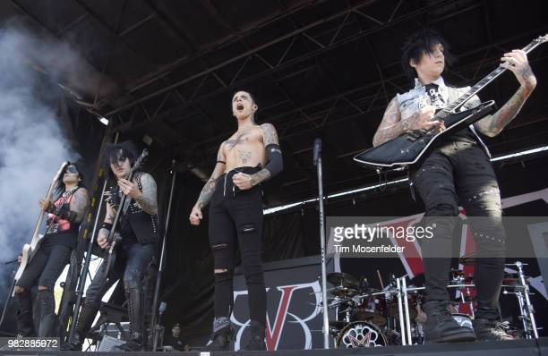 Ashley Purdy Jake Pitts Andy Biersack and Jinxx of Black Veil Brides perform during the 2018 Vans Warped Tour at Shoreline Amphitheatre on June 23...