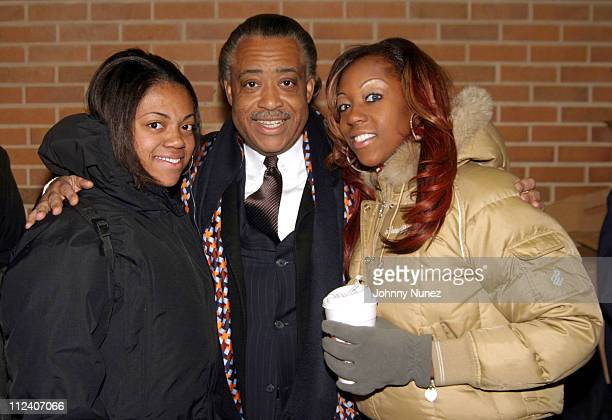 Ashley, Rev. Al Sharpton and Dominique Sharpton during Al Sharpton Christmas Turkey Giveaway at Canaan Baptiste Church Of Christ in New York City,...