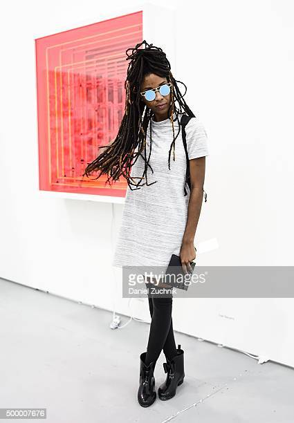 Ashley Rhoden is seen wearing a vintage top with Amazon Fashion boots at Untitled Art Fair on December 4 2015 in Miami Florida