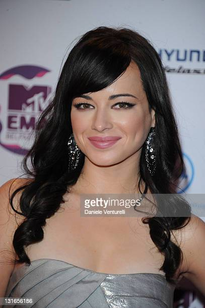 Ashley Rickards poses in front of the media boards at the 'MTV Europe Music Awards 2011' at Odyssey Arena on November 6 2011 in Belfast Northern...