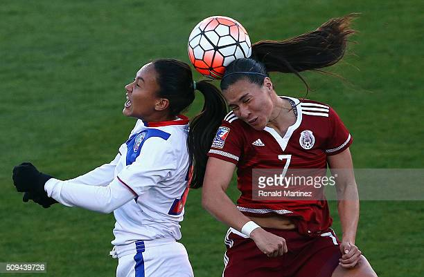 Ashley Rivera of Puerto Rico and Nayeli Rangel of Mexico jump for the ball during 2016 CONCACAF Women's Olympic Qualifying at Toyota Stadium on...