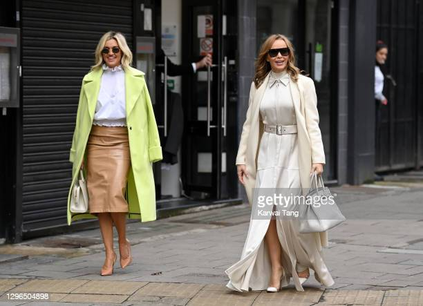 Ashley Roberts and Amanda Holden depart Global Radio studios after finishing their radio shows on January 15, 2021 in London, England.