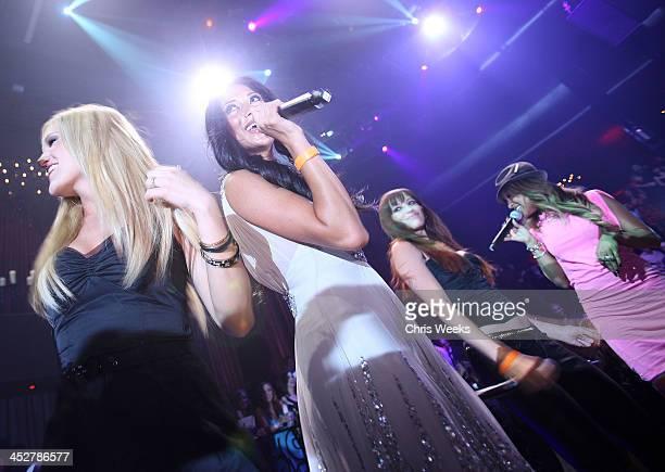 ACCESS*** Ashley Roberts Nicole Scherzinger Jessica Sutta and Melody Thornton of the Pussycat Dolls perform at Scherzinger's birthday at LAX...