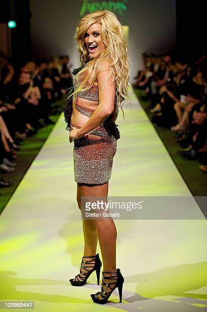 Ashley Roberts of the Pussycat Dolls showcases designs on the catwalk during the Ruth Tarvydas catwalk show as part of Perth Fashion Week 2010 at...