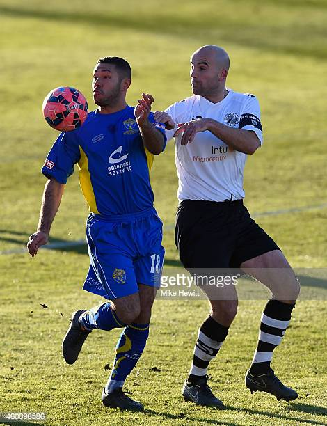 Ashley Ruane of Warrington is challenged by Ben Clark of Gateshead during the FA Cup Second Round tie between Gateshead FC v and Warrington Town at...
