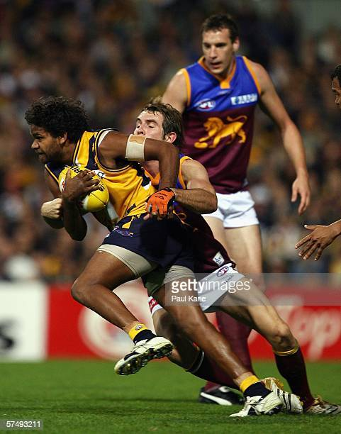 Ashley Sampi of the Eagles attempts to break clear of Joel Macdonald of the Lions during the round five AFL match between the West Coast Eagles and...