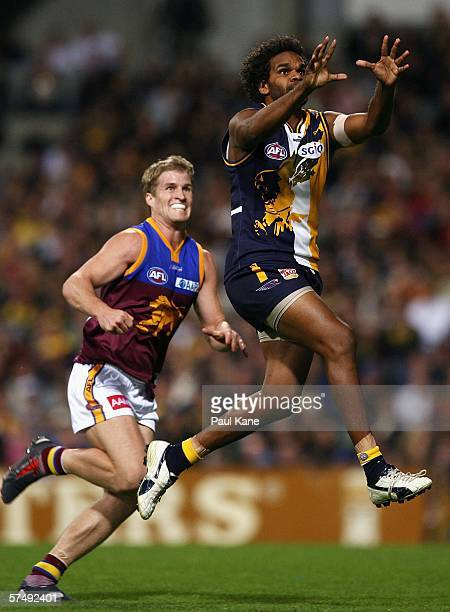 Ashley Sampi of the Eagles Marks in front of Luke Power of the Lions contest the ball during the round five AFL match between the West Coast Eagles...