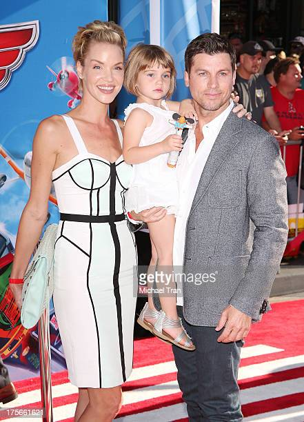 Ashley Scott and her family arrive at the Los Angeles premiere of 'Planes' held at the El Capitan Theatre on August 5 2013 in Hollywood California