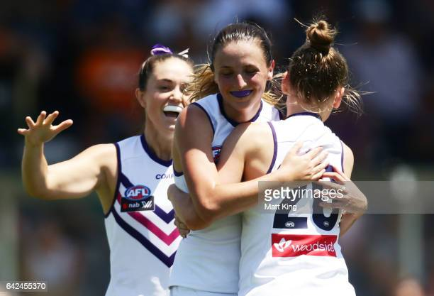 Ashley Sharp of the Dockers celebrates with team mates after kicking a goal during the Women's round three match between Greater Western Sydney...