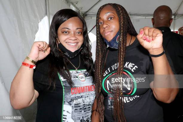 """Ashley Sharpton and Dominique Sharpton-Bright pose backstage during the """"Get Your Knee Off Our Necks"""" Commitment March on Washington at the Lincoln..."""