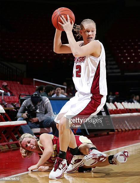 Ashley Sharpton bowls over Jessica Williams of Elon at the University of Maryland Terripin Classic on December 30, 2004 at the Comcast Center in...