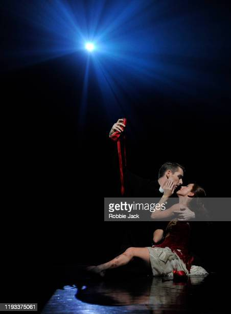 """Ashley Shaw as Victoria Page and Liam Mower as Ivan Boleslawsky in Matthew Bourne's """"The Red Shoes"""" at Sadler's Wells Theatre on December 11, 2019 in..."""