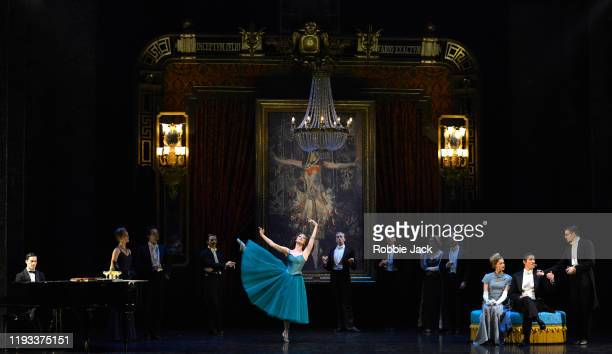 """Ashley Shaw as Victoria Page with artists of the company in Matthew Bourne's """"The Red Shoes"""" at Sadler's Wells Theatre on December 11, 2019 in..."""