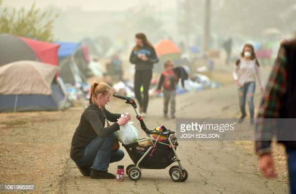 Ashley Sheppard whose house burned down tends to her baby at an evacuee encampment in a Walmart parking lot in Chico California on November 15 2018...
